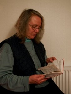 Translator reading Pali book
